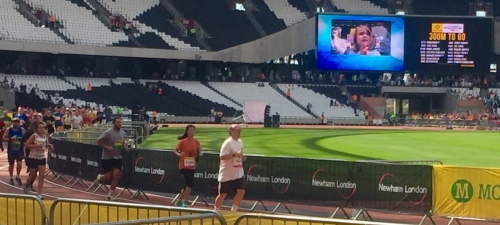 Photo of Sean running in the Olympic Stadium