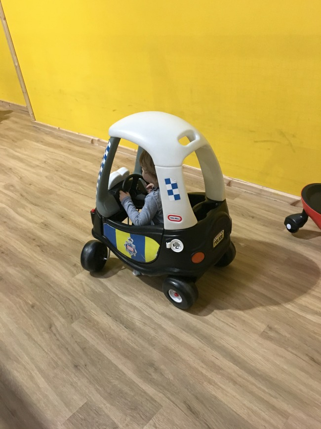 Mambo-Soft-Play-Cardiff-A-Toddler-Explores-image-of-toddler-on-toy-car
