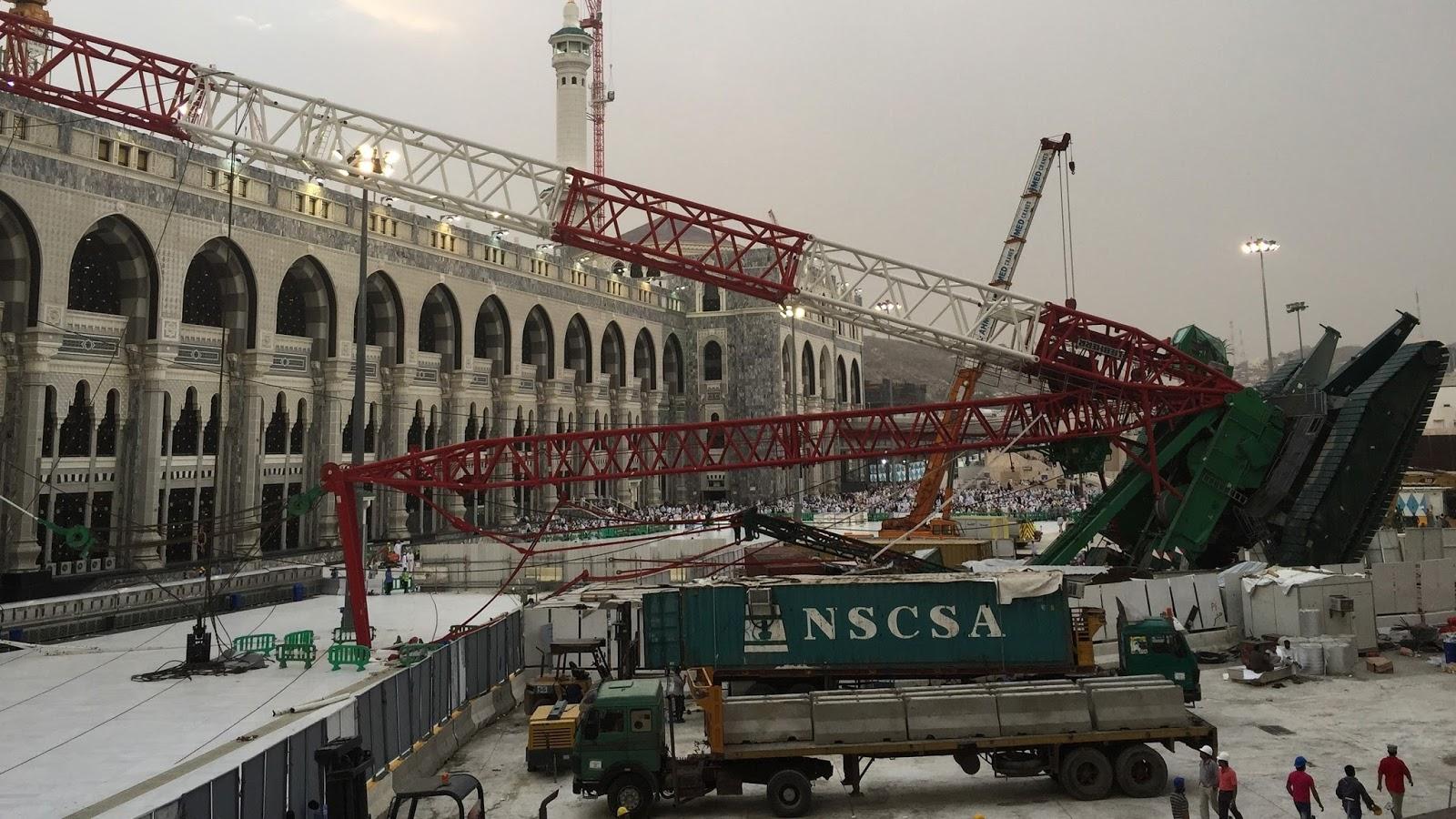 crawler crane falling backwards into the mecca mosque