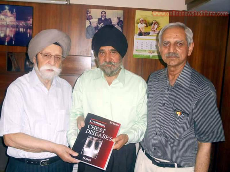 Dr L S Chawla with Dr R S Bhatia and Dr Arun Mitra releasing text book on respiratory medicine