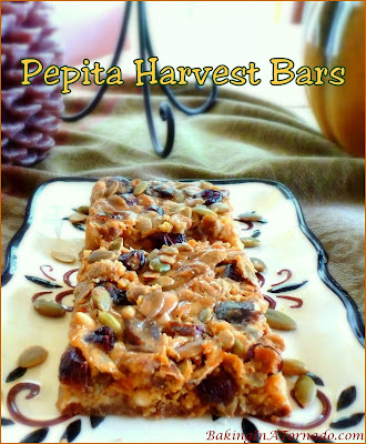 Pepita Harvest Bars are an interpretation of the classic seven layer bars incorporating all of the flavors of the Fall Season. | Recipe developed by www.BakingInATornado.com | #recipe #dessert