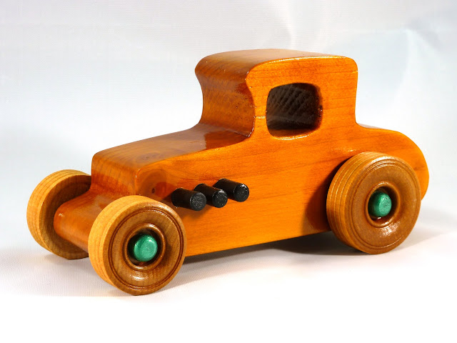 Left Front - Wooden Toy Car - Hot Rod Freaky Ford - 37 T Coupe - Pine - Amber Shellac - Metallic Green Hubs