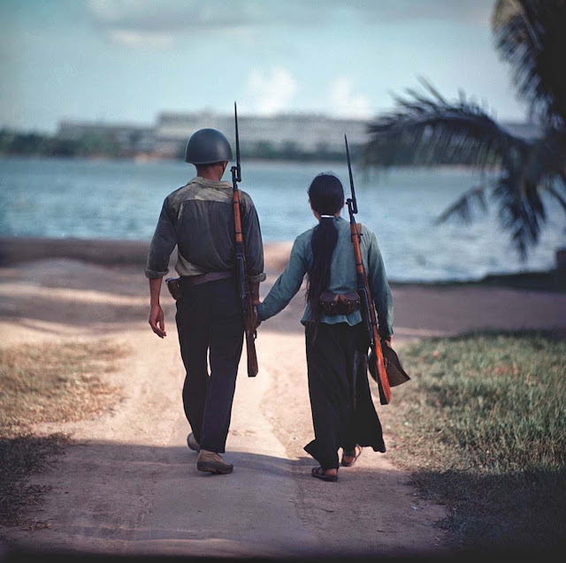A couple of warriors holding hands, Vietnam, 1971.