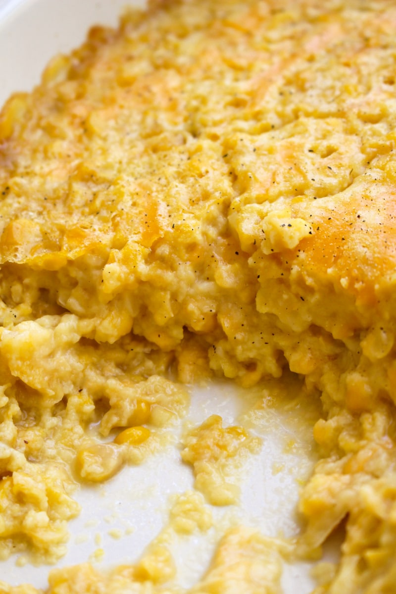 This Baked Creamed Corn is super easy to make and goes with any protein. It's easy enough to make on a weeknight and makes a great holiday side dish, too! #sidedish #cornrecipe