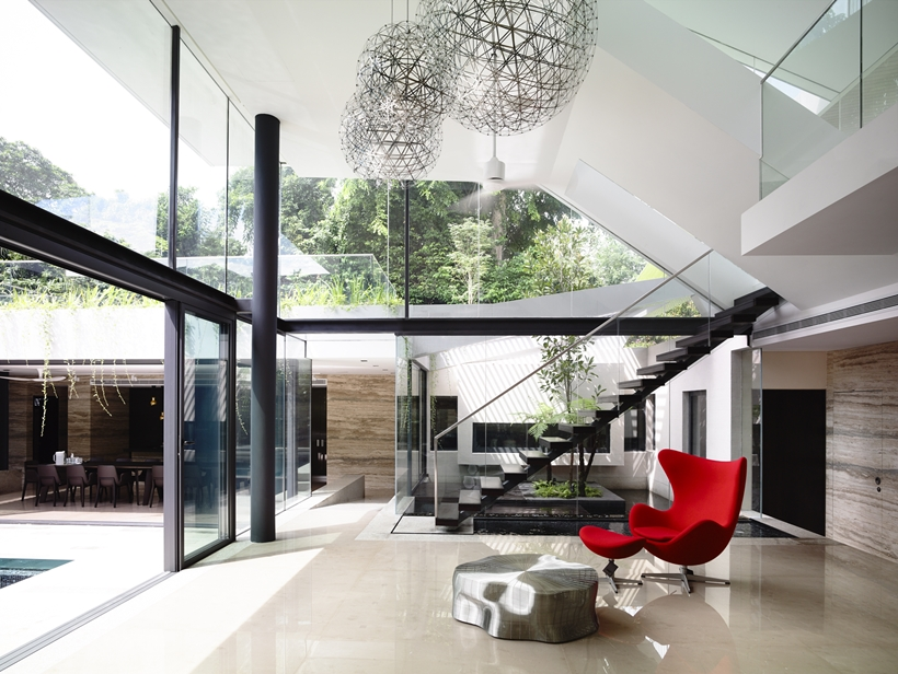 Glass walls of an Impressive dream home in Singapore by a-dlab