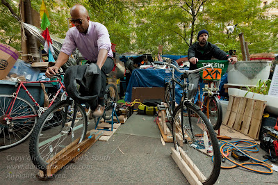 a photo of people generating power with bicycles at the occupy wall street encampment