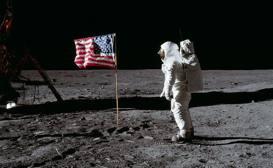 Astronaut Buzz Aldrin salutes the deployed United States flag during an Apollo 11 Extravehicular Activity (EVA) on the lunar surface. Photographer Astronaut Neil A. Armstrong. July 20, 1969.