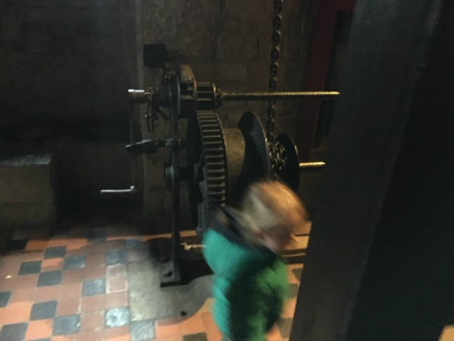 Winding gear with very blurred image of toddler