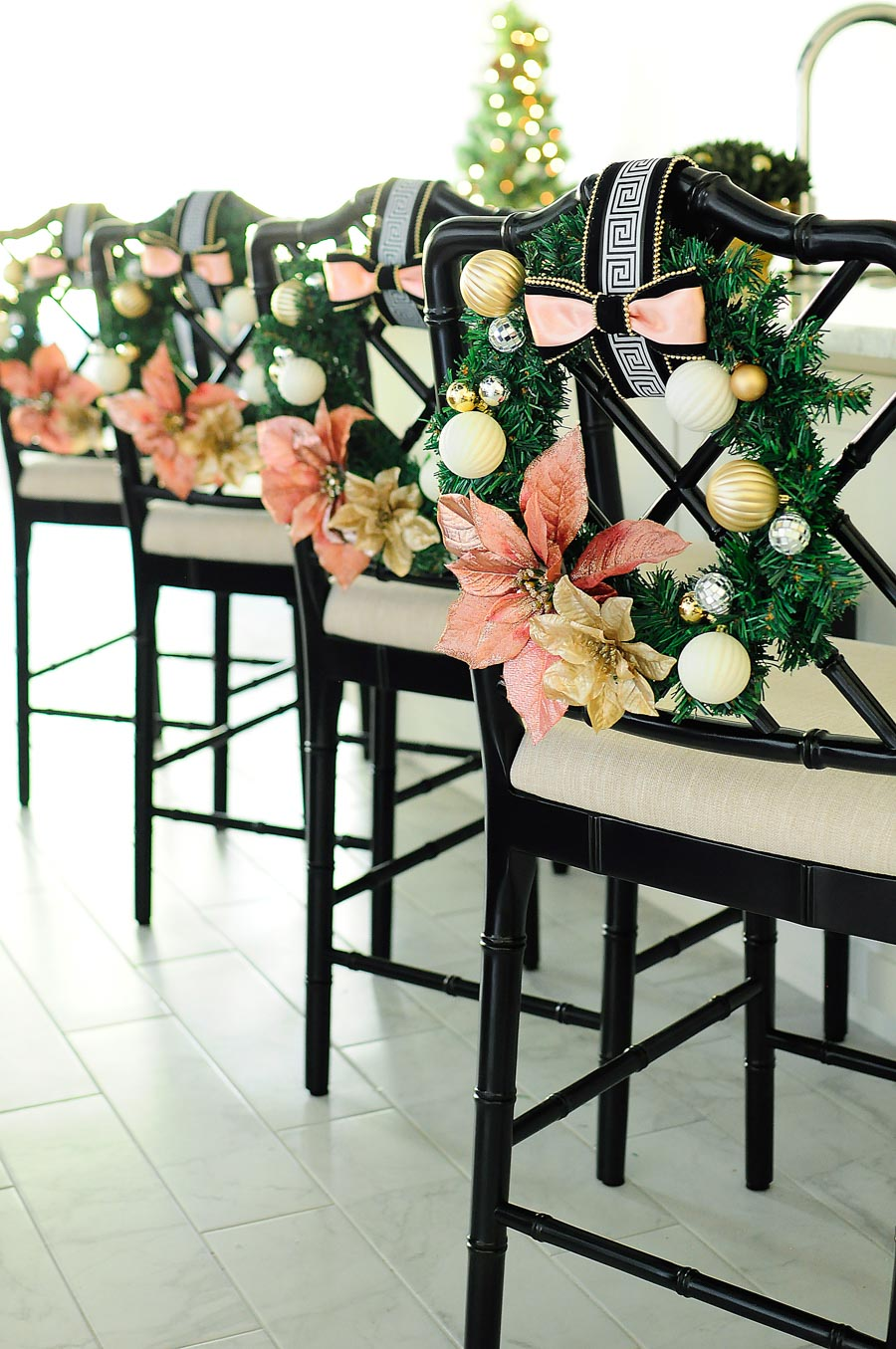 Chinoiserie barstools decorated with blush, white, silver and gold accents for the Christmas/holiday season.