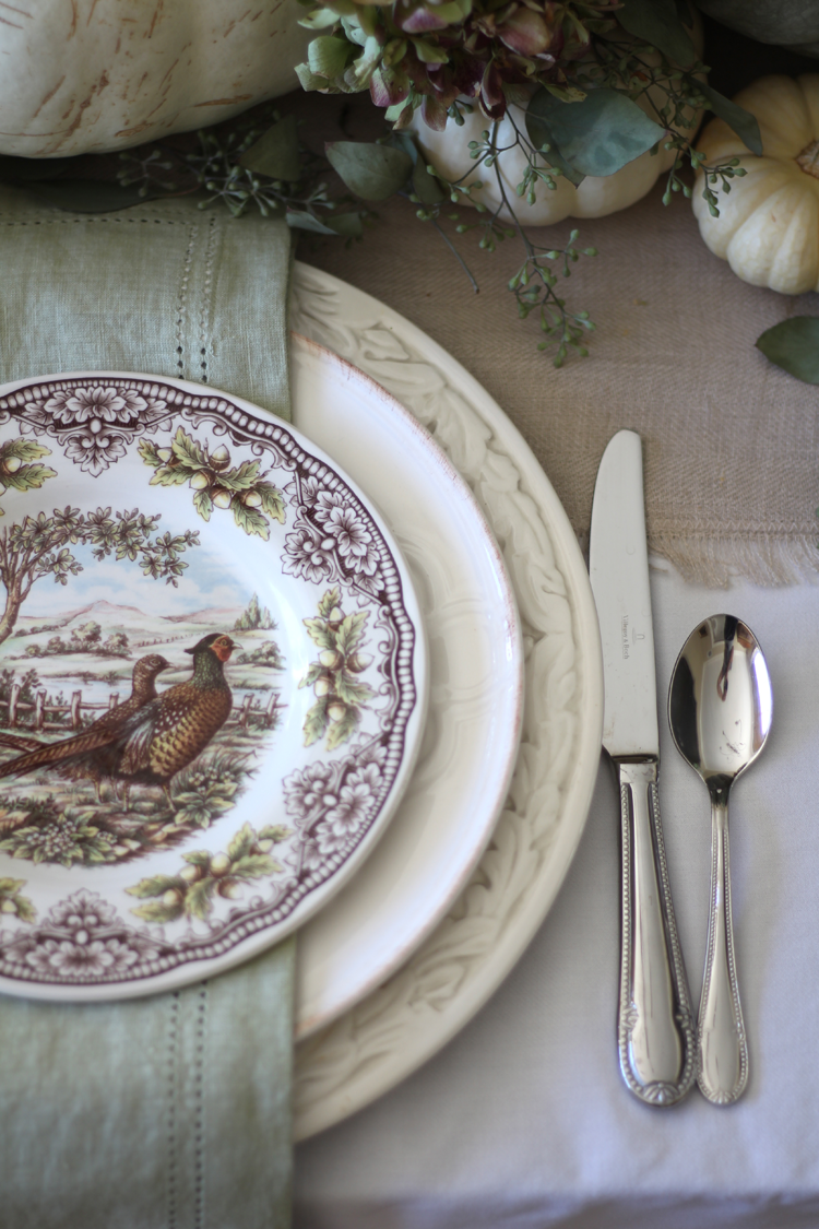 neutral fall tablescape with cream dishes transferware and green accents