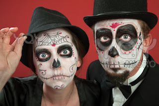 day of the dead makeup couple with hats