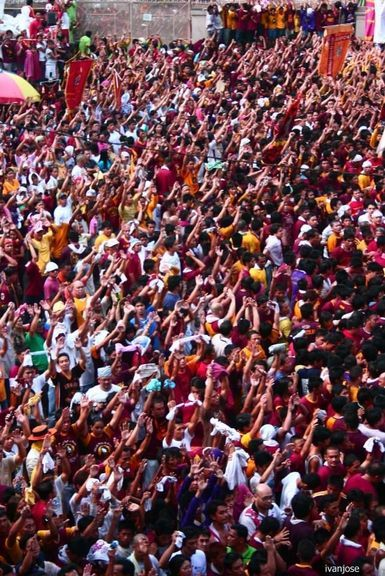 Devotees raising their hands as the Black Nazarene procession approached Quiapo Church during Holy Week