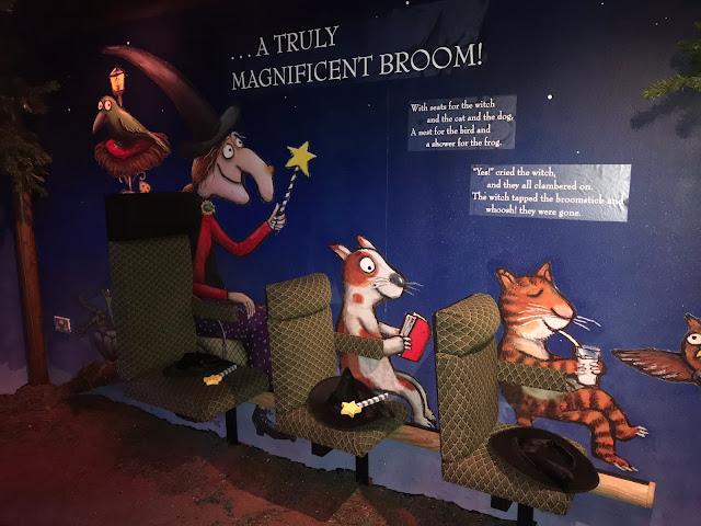 A painting on the wall showing the characters from Room on the Broom and actual chairs attached to a broom