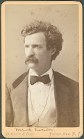 A photograph of Mark Twain.