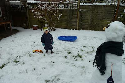 Snow day with children in the garden