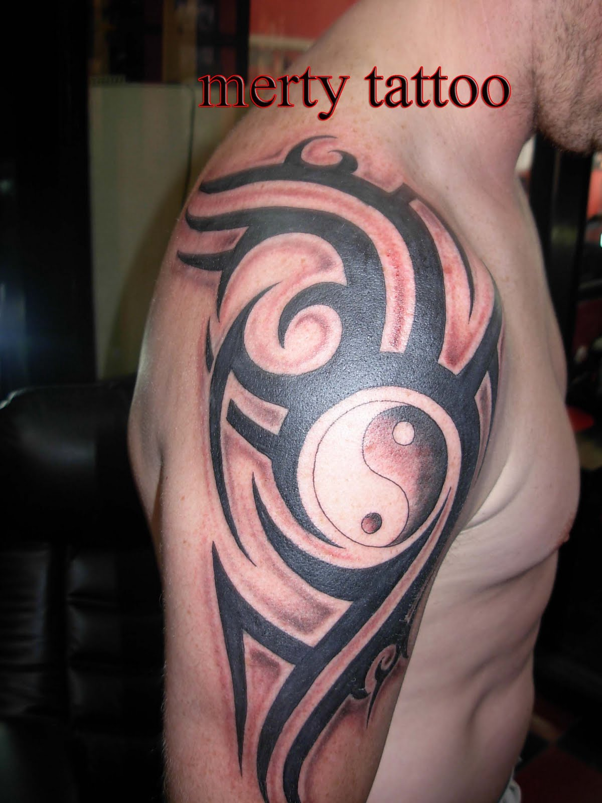 Tribal and logo tattoo merty tattoo