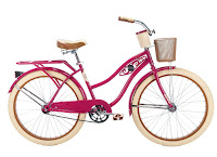 "Huffy Bicycles Women's 26"" Deluxe Fairview Cruiser Bike, steel frame finished in pink, swept-back handlebars, 26"" cruiser tires, large padded spring saddle, single speed, coaster brake"