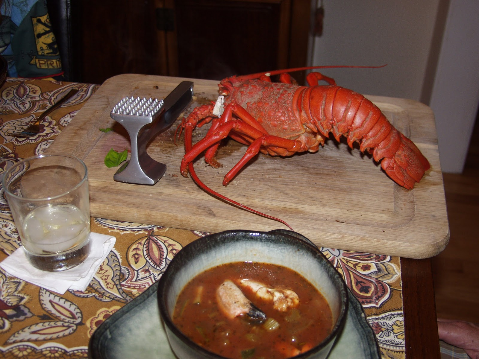 What Eye 8 Cioppino Chopping Up Veggies Tossing In Fish And Serving Up Hearty Food Joy