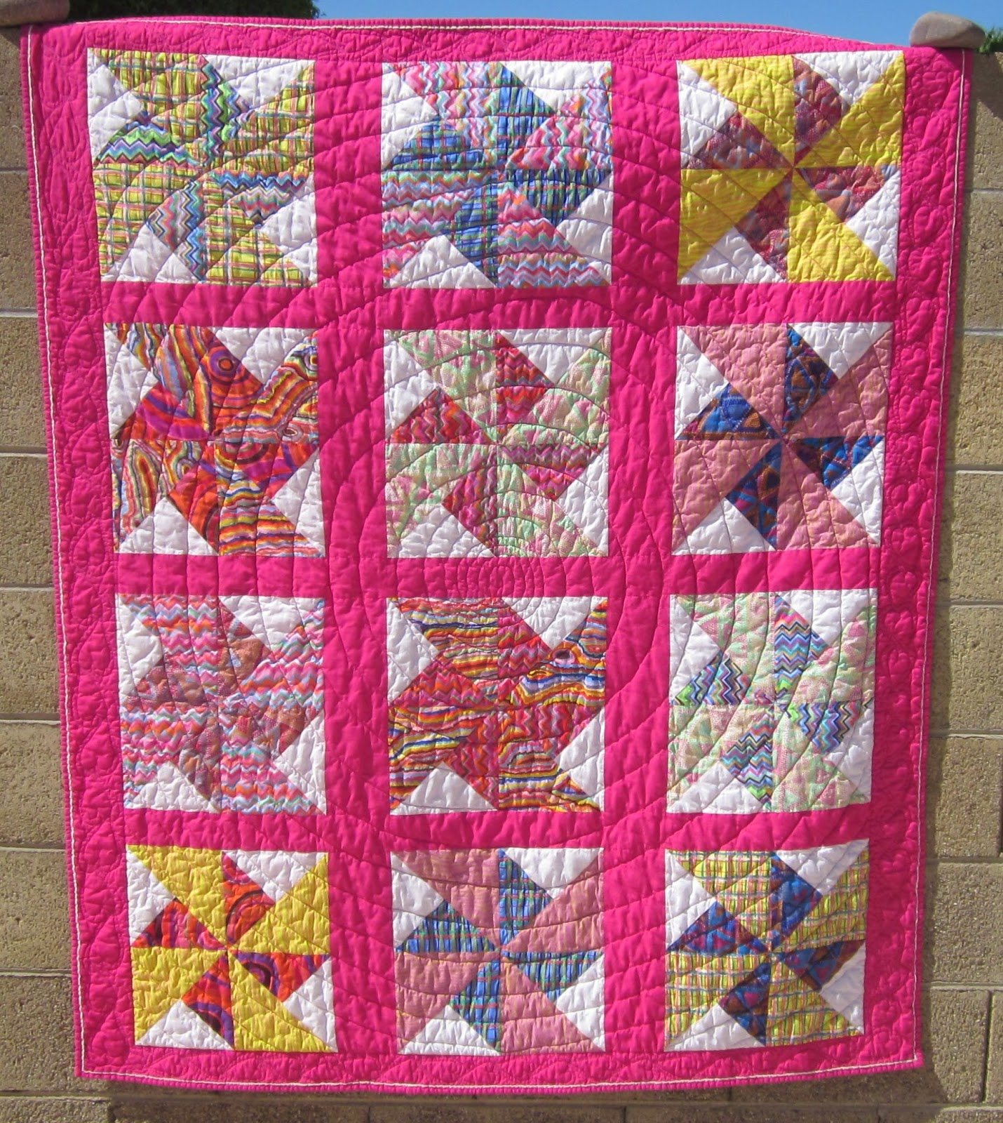 http://www.quiltparadigm.blogspot.com/2014/03/double-pinwheel-done.html