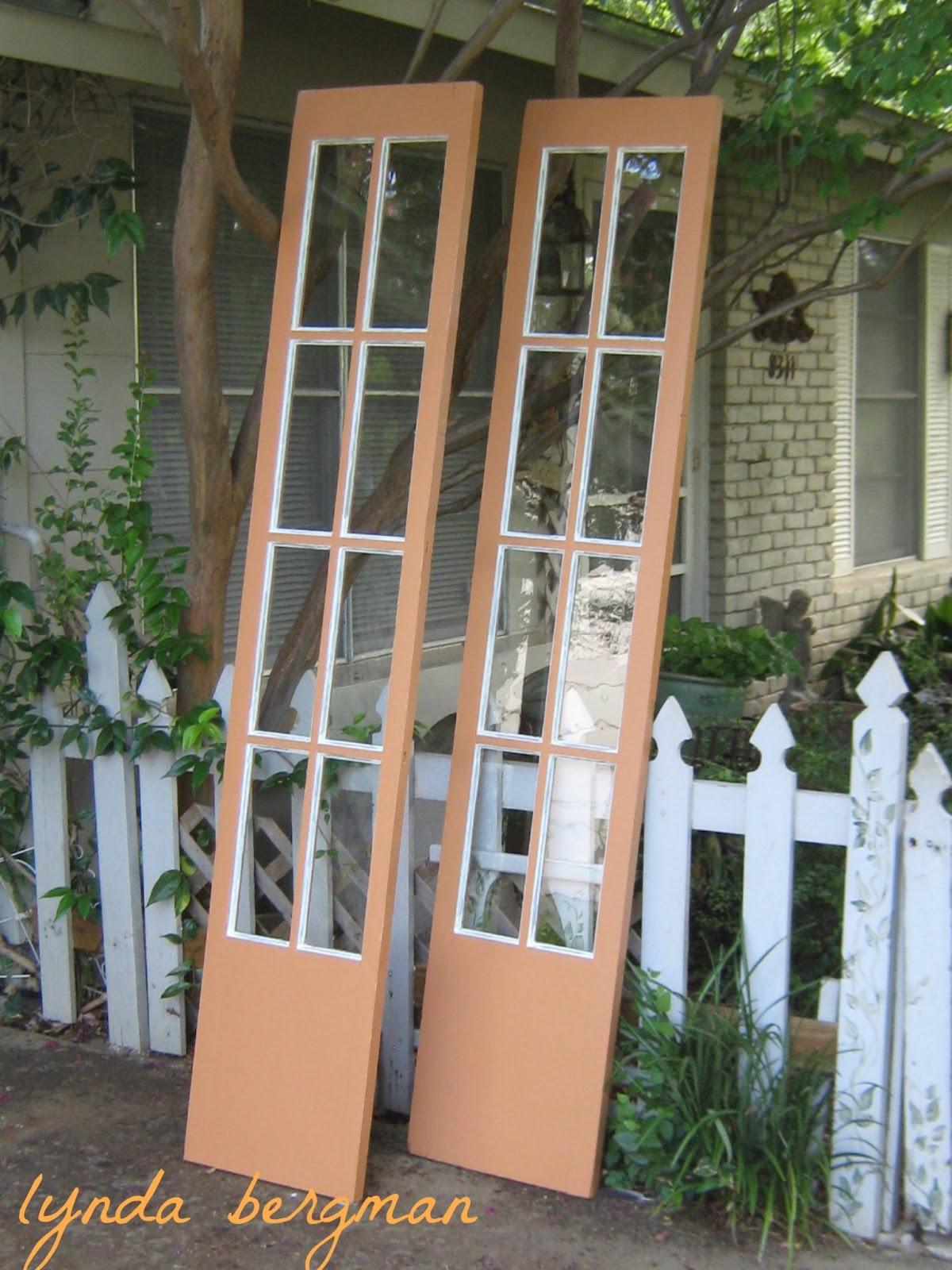 Lynda bergman decorative artisan orange french doors for for Narrow interior french doors