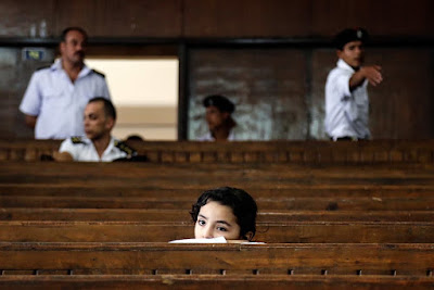The girl waiting for her father's trial
