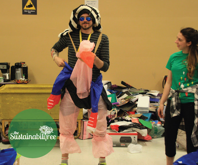 A volunteer dresses up with donations to the Dump and Run