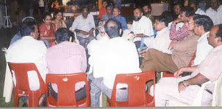Participants in discussion during dinner