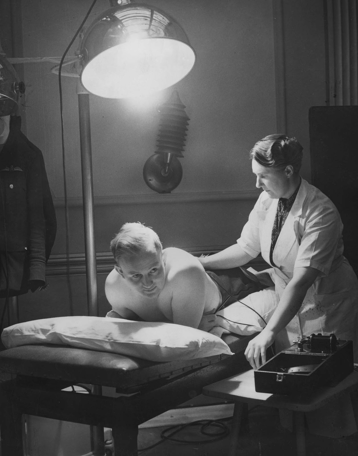 An RAF Flying Officer receiving Sun-Ray and electrical treatment after suffering a broken back. 1941.