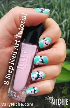 Spring Blossoms Nail Art Design by Vary Niche dot com: Pink and White Blossoms on a branch painted across fingernails with a teal background.