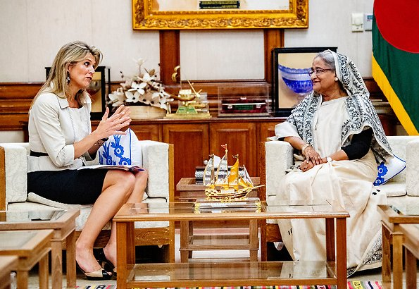 Queen Maxima wore a floral print silk blouse and floral print silk midi skirt, and Ntan pumps, fruit earrings, One & Only clutch