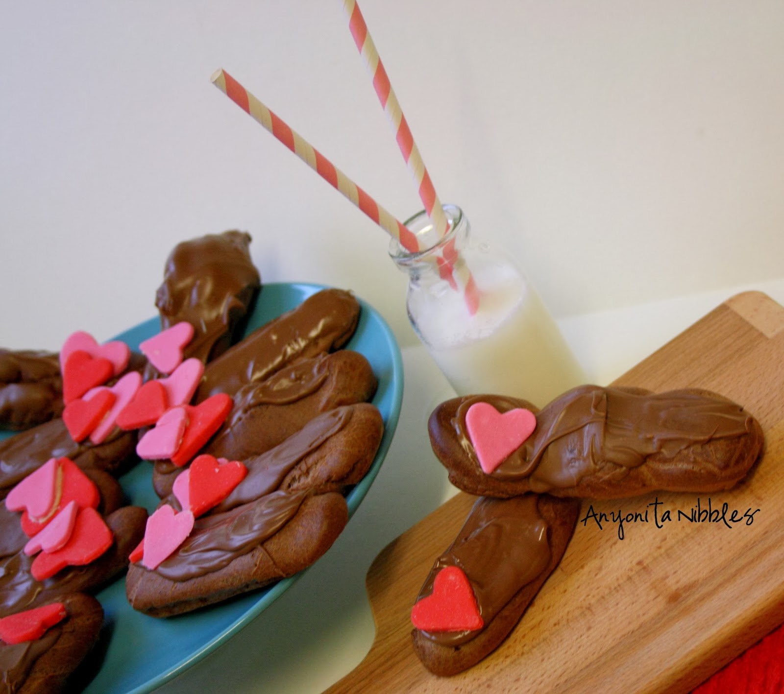 Triple chocolate eclairs with Nutella mascarpone cream, fondant hearts and milk