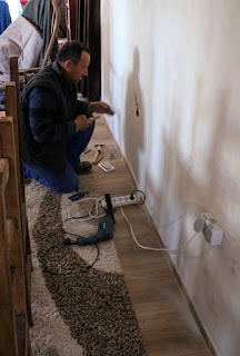 Bekir works along the back wall