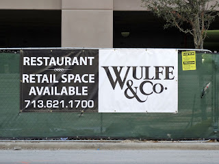 WULFE & CO Restaurant / Retail Leasing Banner at Downtown Construction Site