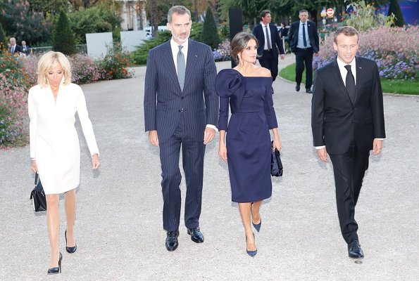 Queen Letizia wore DELPOZO flower embellished long sleeved dress. French President Emmanuel Macron and First Lady Brigitte Macron