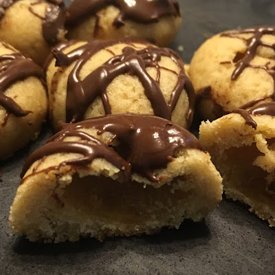 brown sugar cookie, drizzled with chocolate, and cut in half to reveal a hollow center