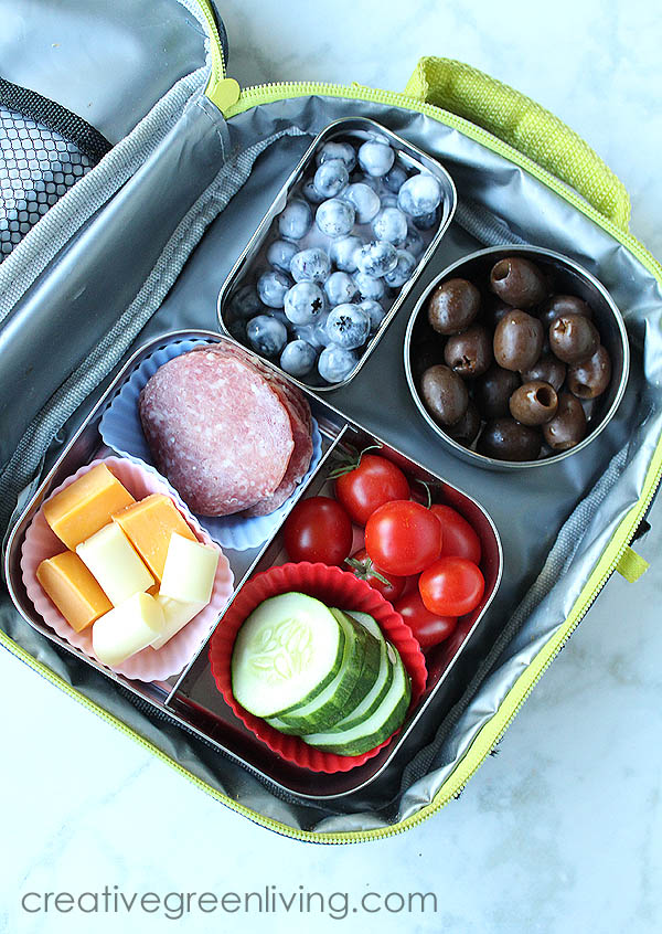 Easy gluten free bento box lunch idea - deconstructed chef salad with salami, cheese, tomatoes, olives and fruit salad