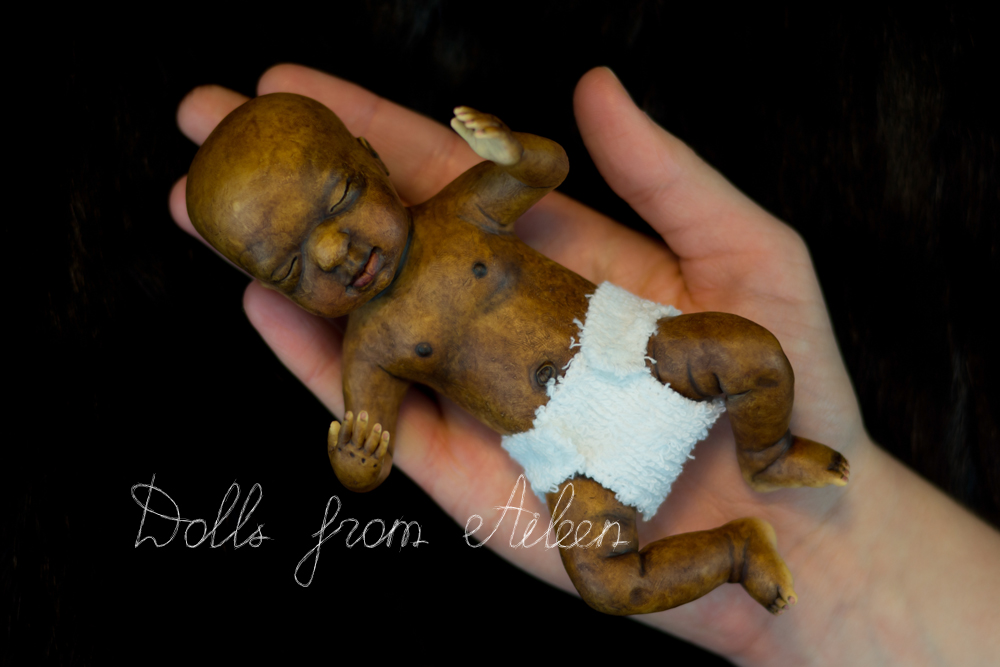 OOAK anatomically correct sleeping African baby boy doll on human hand