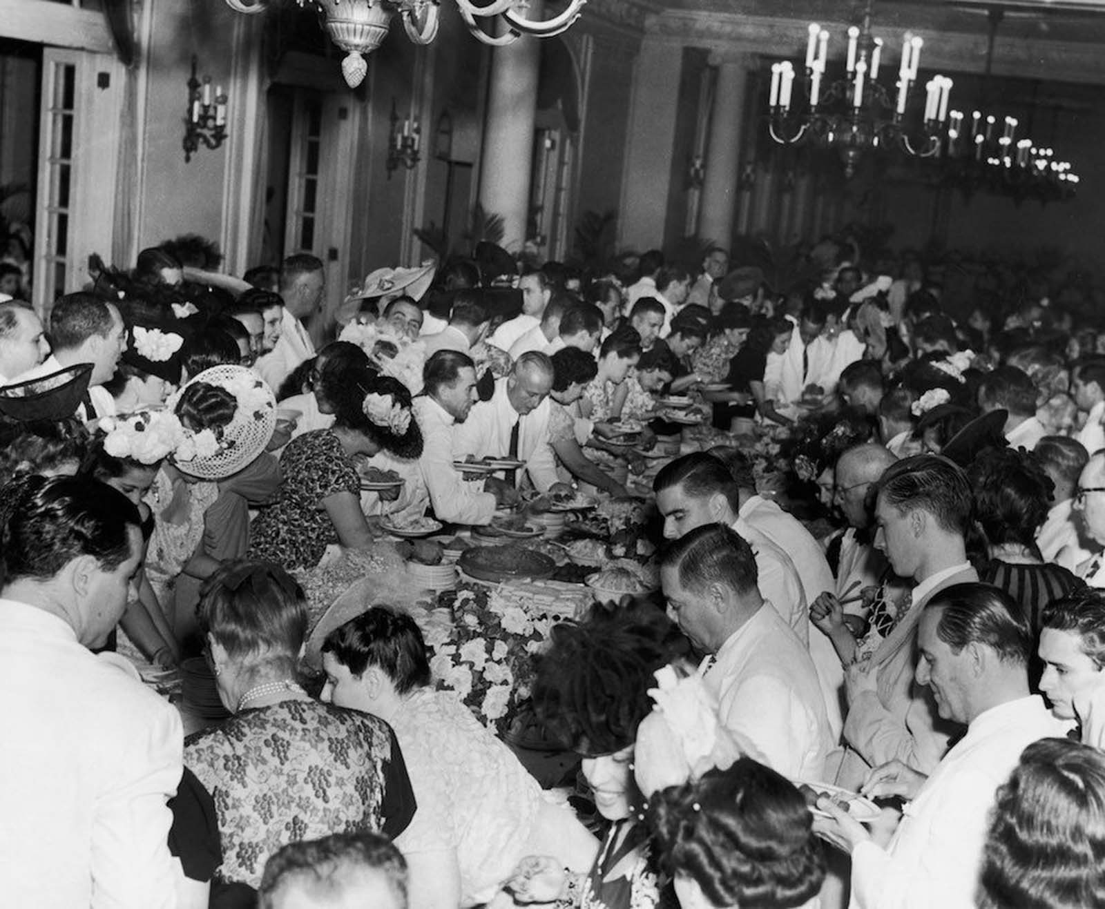 Guests enjoying a buffet supper at the Havana Yacht Club. c. 1950.