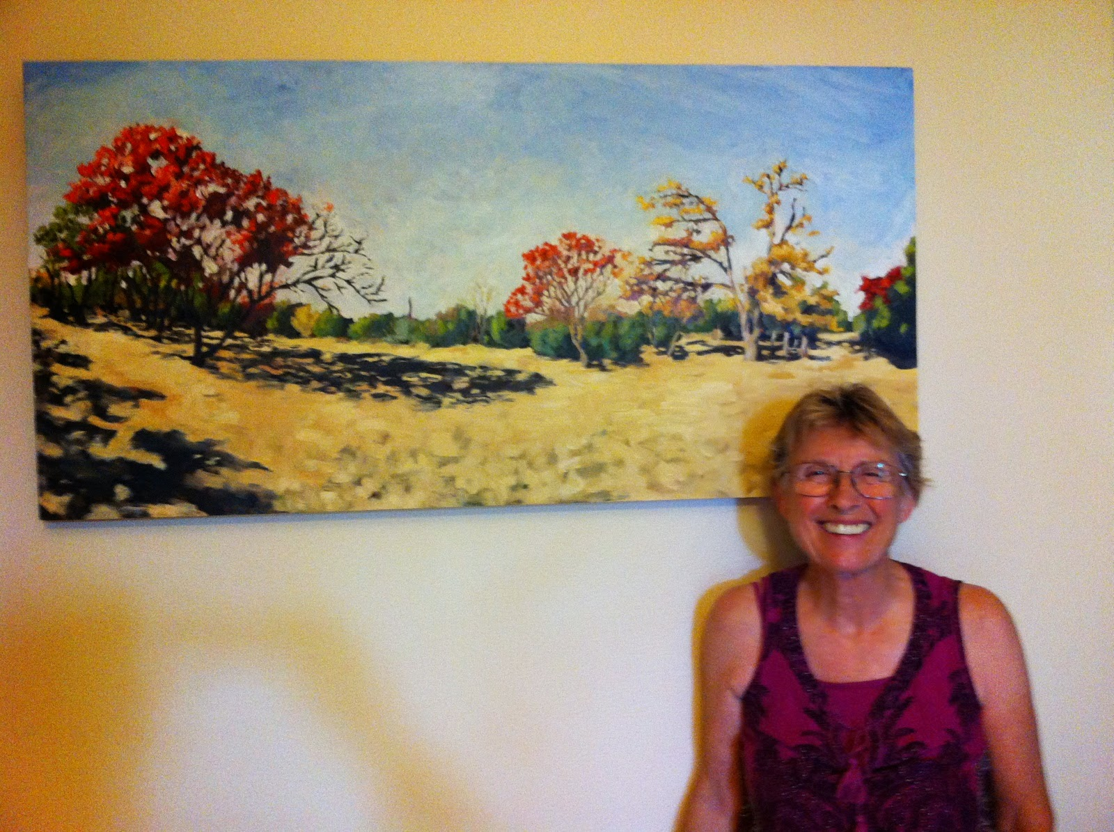 landscape painting by David Borden with the proud owner