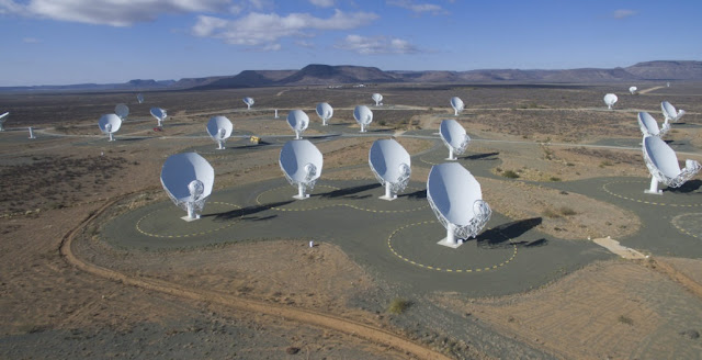 An overhead view of South Africa's MeerKAT radio-telescope array while it was under construction. The 64-dish network was inaugurated in July 2018. Credit: SKA South Africa