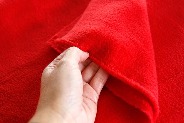 Selvage edges of red polar fleece fabric
