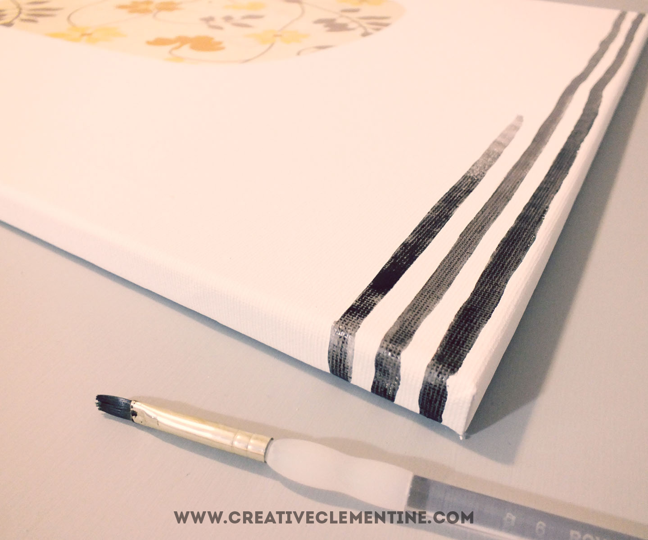 Easy hand painted DIY stripey quote art via creativeclementine.com. Step 2-3: Cover the quote with contact paper. Start painting stripes with watercolours.