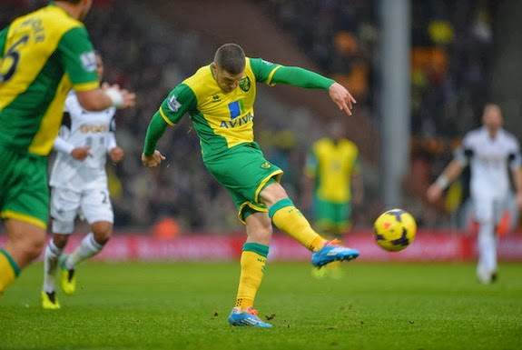 Norwich striker Gary Hooper shoots to score his team's equaliser against Swansea