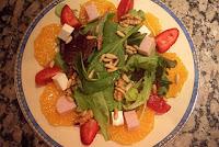 Carpaccio de naranja, ensalada de brotes tiernos y vinagreta de fresas