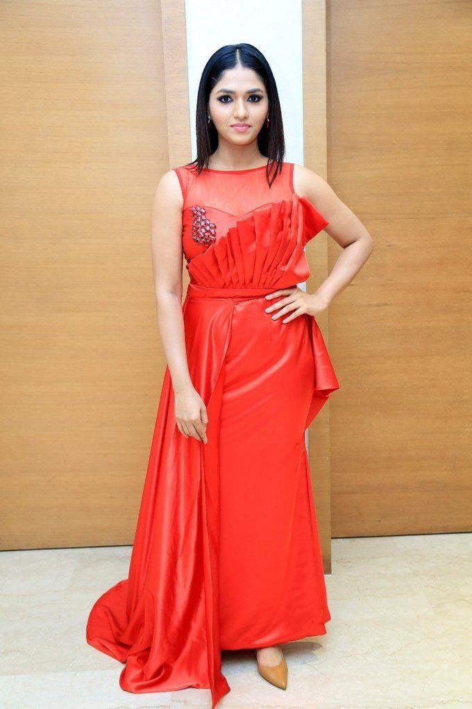 Punjabi Actress Sunaina Singh Stills In Long Orange Color Gown