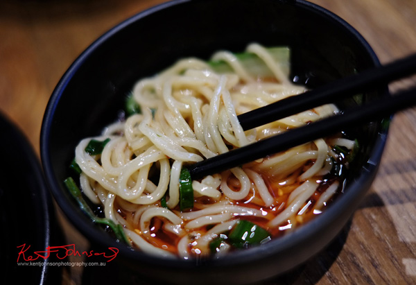 Serving of Chongqing Spicy Noodles at Zoo Family restaurant. Food photography by Kent Johnson.