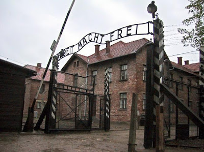Entrance gate with lettering Arbeit macht frei Auschwitz Concentration Camp