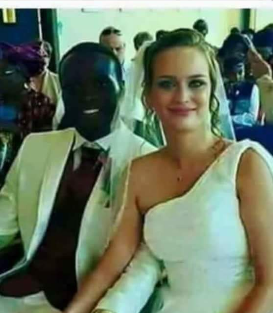 A strange picture of a very black man got married from a white woman .