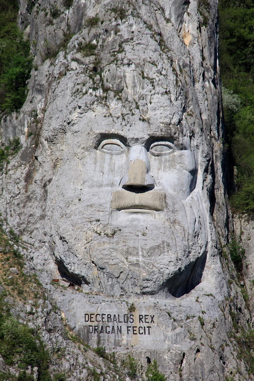 The face of Decebalus, king of the Dacia (87–106 AD). Dacia the pre-Roman name of Romania. A high relief carved on the wall of a mountain, on the river Danube near Orsova, Romania. The highest (42.9 m) rock sculpture in Europe.