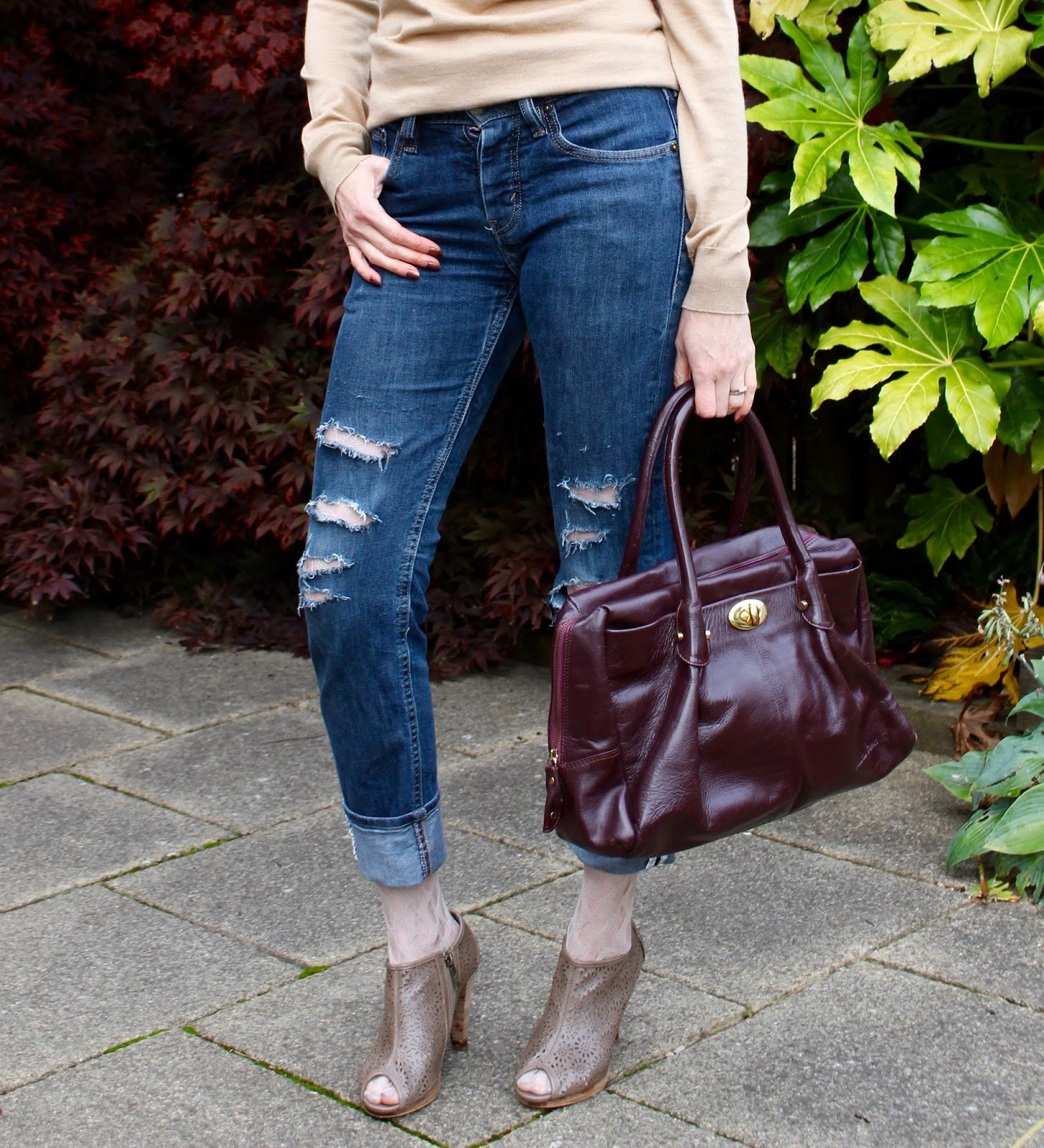 Cashmere, leather bag and distressed Levis | Fake Fabulous